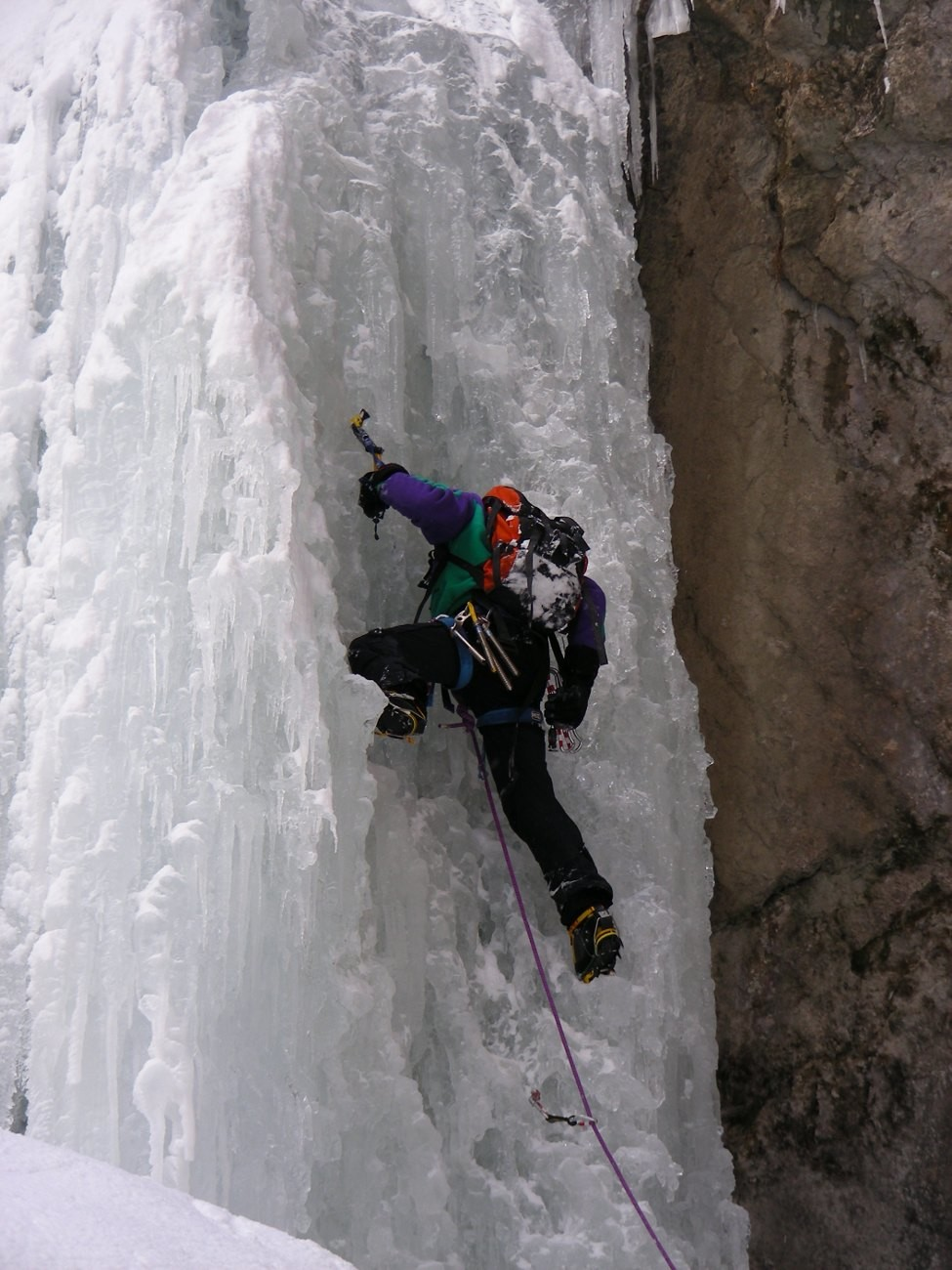 A climber on pitch 3 (the ice has been heavily battered)