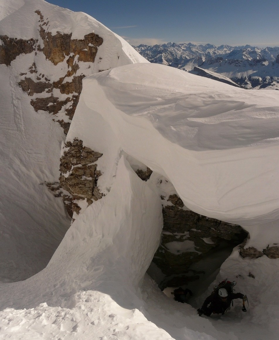 Crossing of a small natural arch under a big cornice