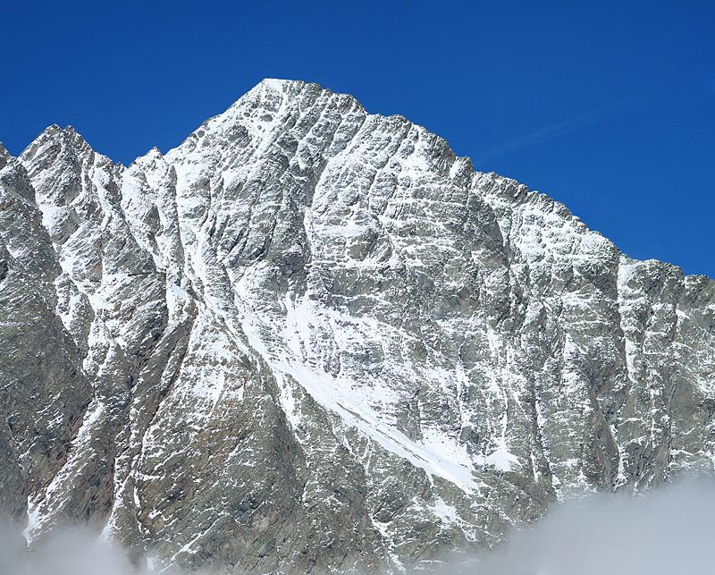 Immagine ravvicinata di 6 foto con il teleobiettivo del versante S del Piz Linard 3411 m visto dal Piz Glims 2868 m.