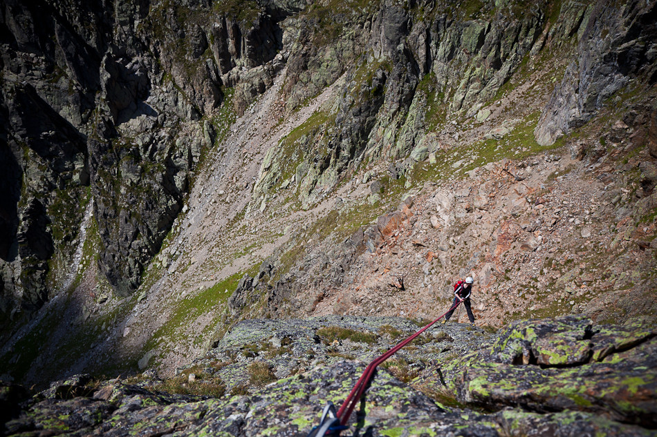"Abseil from the ""wrong"" belay at the summit."