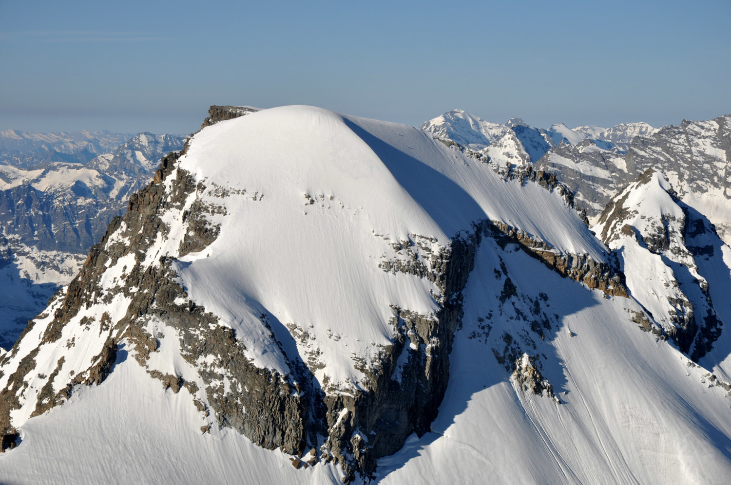 Ciarforon (3641m) : north face. Climbers on the final snow slope