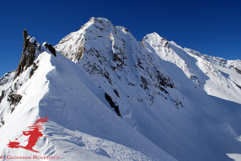 Dal Passo di Vazzeda 2967m, vista sulla Cima di Vezzeda 3297m e sulla Cima di Rosso 3366m