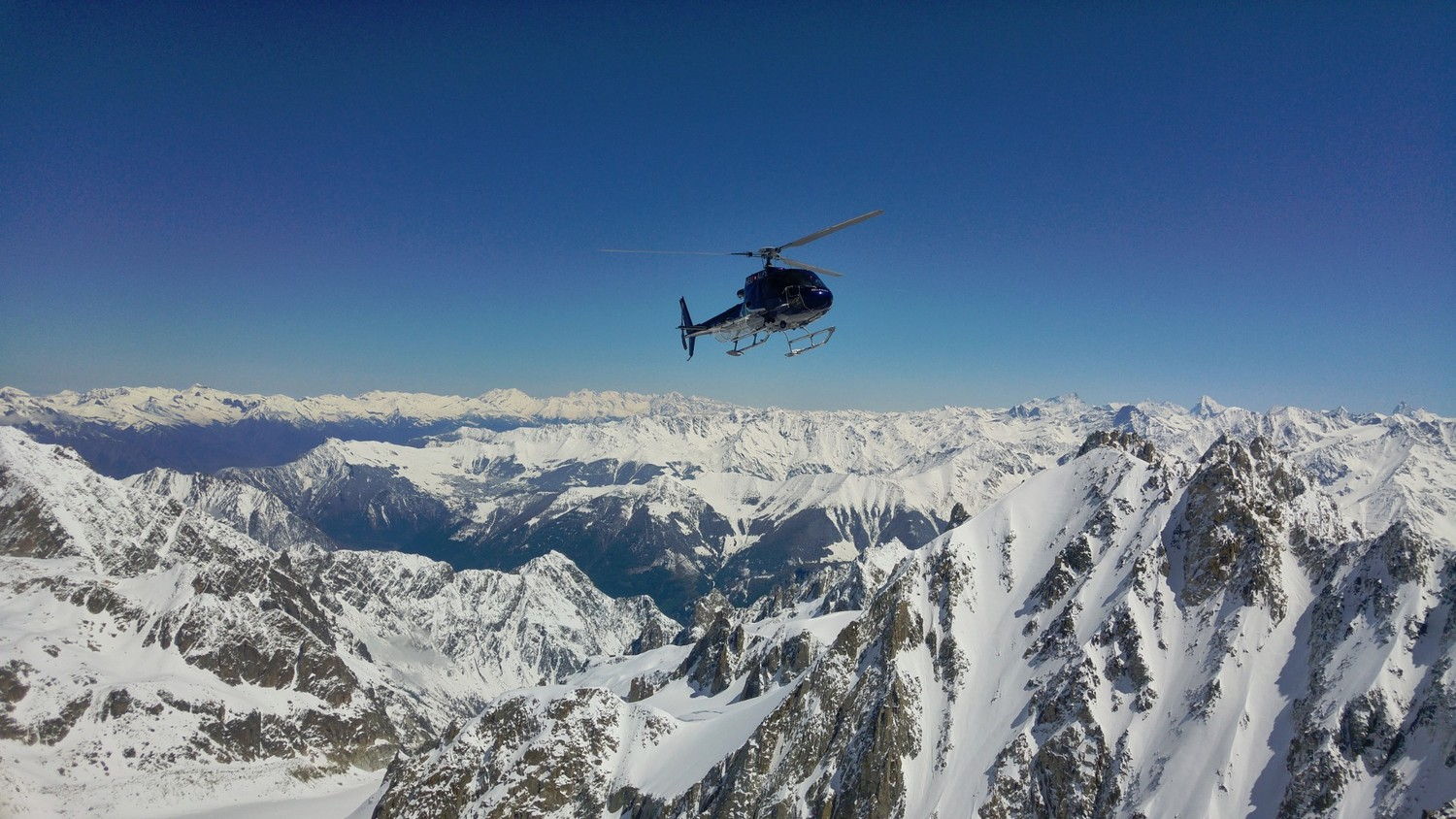 Apparently heli skiing helicopter from Switzerland dropping people directly at the ridge above the Col du Tour Noir..