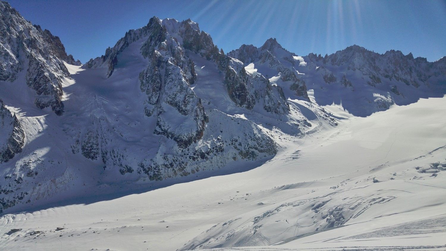 View over the Glacier d'Argentiere valley. Lots of fresh snow and the glacier not yet tracked. Rare view in April